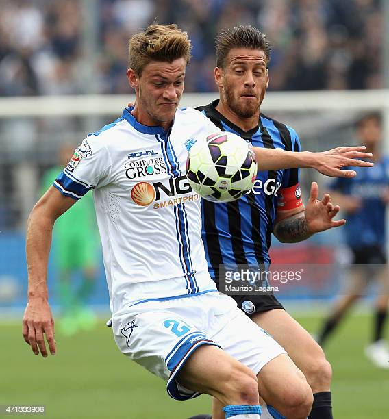 German Denis of Atalanta competes for the ball with Daniele Rugani of Empoli during the Serie A match between Atalanta BC and Empoli FC at Stadio...