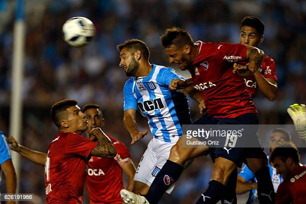German Denis of Independiente and Lisandro Lopez of Racing Club fight for the ball during a match between Racing Club and Independiente as part of...