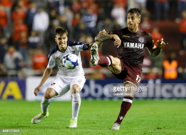 German Denis of Lanus fights for the ball with Nicolas Tagliafico of Independiente during a match between Independiente and Lanus as part of the...