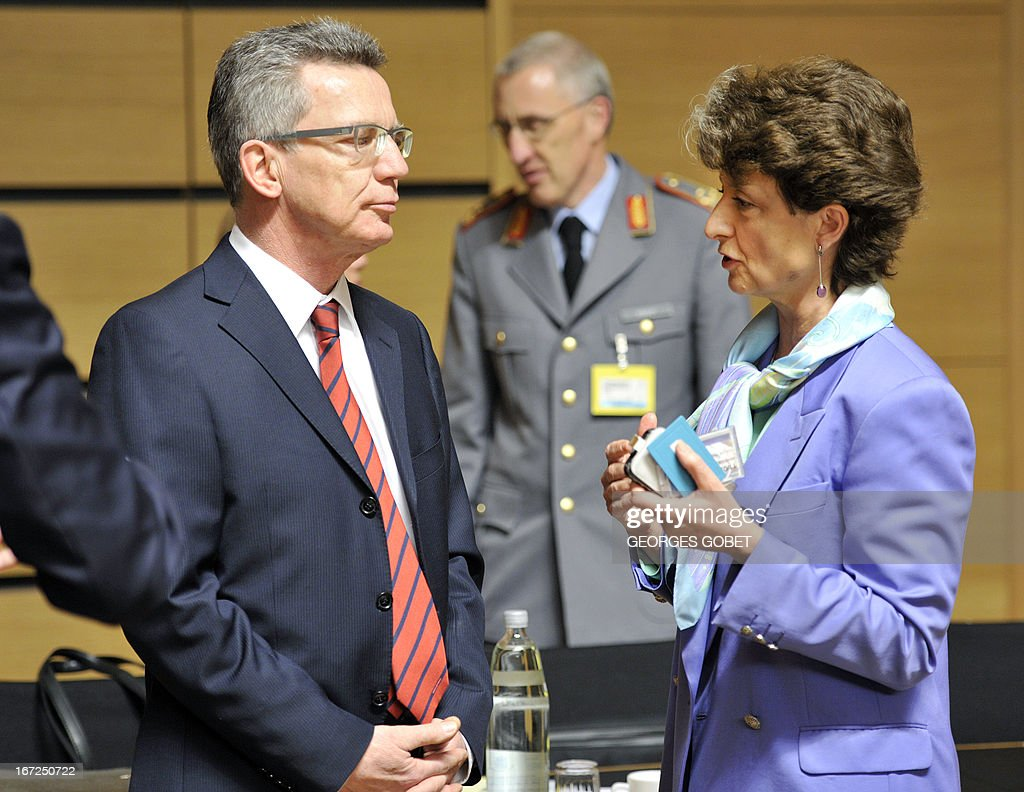 German deputy Federal Minister of Defence Thomas de Maiziere and Chief Executive of Europrean Defence Agency Claude France Arnould (R) talk prior a Foreign Affairs Council (Defence) on April 23, 2013 at the Kirchberg conference center in Luxembourg. EU defence ministers will hold their six-monthly meeting in the framework of the Foreign Affairs Council. They will discuss the situation in the Sahel, Mali and the EU training mission in Mali.