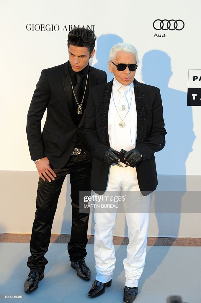 German designer Karl Lagerfeld (R) and French model Baptiste Giabiconi pose while arriving to attend the 2010 amfAR's Cinema Against Aids on May 20, 2010 in Antibes, southeastern France.