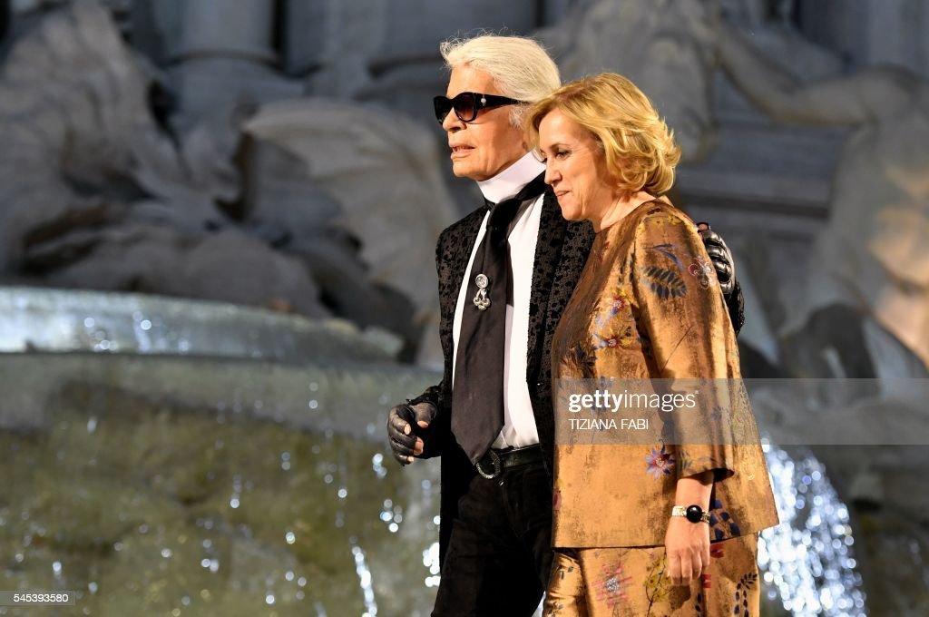 designer for fendi dyns  German designer Karl Lagerfeld L and Silvia Venturini Fendi acknowledge  the audience at the end of the Fendi fashion show at the Trevi Fountain in  Rome on
