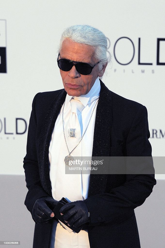 German designer Karl Lagerfeld poses while arriving to attend the 2010 amfAR's Cinema Against Aids on May 20, 2010 in Antibes, southeastern France.