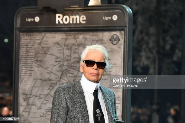 German designer Karl Lagerfeld walks the runway at the end of the 12th Chanel Metiers dArt show 'ParisRome' an annual event to honor craftsmanship...