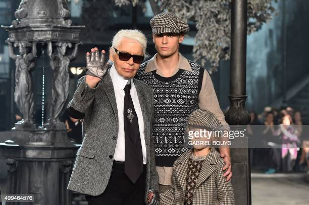 German designer Karl Lagerfeld walks the runway with his godson Hudson Kroenig at the end of the 12th Chanel Metiers dArt show 'ParisRome' an annual...