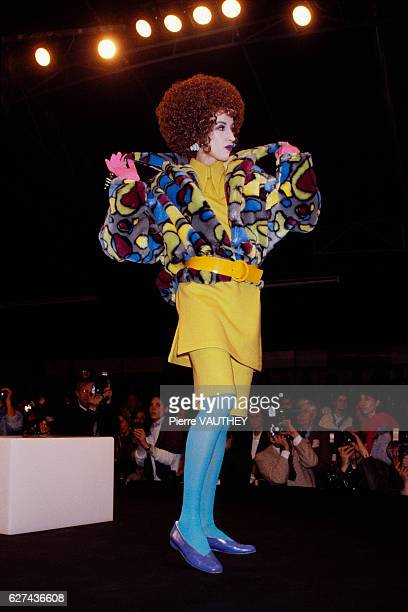 German designer Thierry Mugler shows his 19851986 fallwinter women's readytowear line in Paris The model is wearing a brightly patterned plush coat...