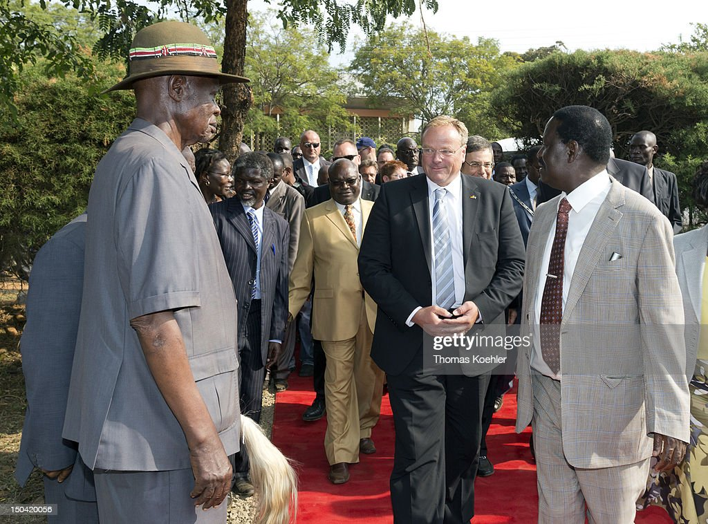 German Development Minister Dirk Niebel (C) and Kenyan Prime Minister <a gi-track='captionPersonalityLinkClicked' href=/galleries/search?phrase=Raila+Odinga&family=editorial&specificpeople=2147626 ng-click='$event.stopPropagation()'>Raila Odinga</a> (R) meet for discussions on August 16, 2012, in Kisumu, Kenya. Meeting topics will include the Kenyan presidential election in 2013 and a development cooperation between Germany, Israel and Kenya.