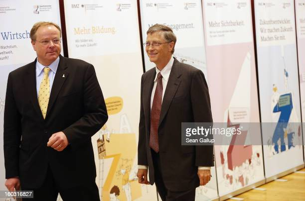 German Development Minister Dirk Niebel and Microsoft founder Bill Gates arrive to speak to the media after talks at the Development Ministry on...