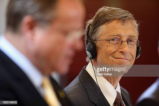 German Development Minister Dirk Niebel and Microsoft founder Bill Gates speak to the media after talks at the Development Ministry on January 29...
