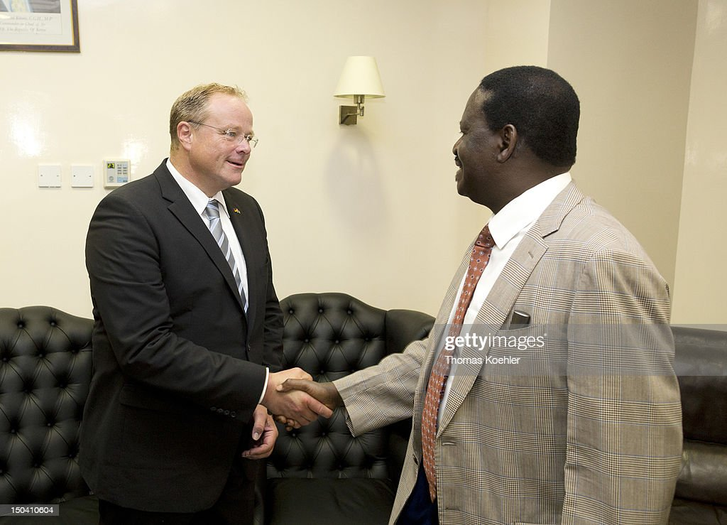 German Development Minister Dirk Niebel (L) and <a gi-track='captionPersonalityLinkClicked' href=/galleries/search?phrase=Raila+Odinga&family=editorial&specificpeople=2147626 ng-click='$event.stopPropagation()'>Raila Odinga</a>, Prime Minister of Kenya greet each otehr on August 16, 2012, in Kisumu, Kenya. The ministers discussed the presidential election in 2013 and a development cooperation between Germany, Israel and Kenya.
