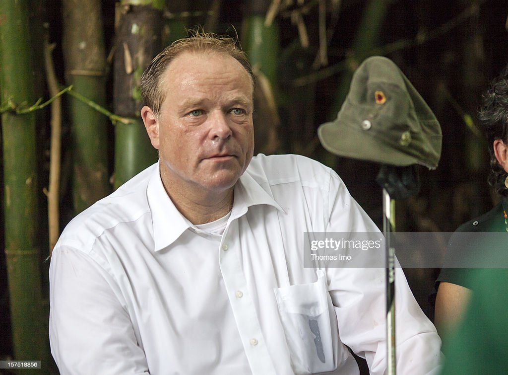 German Development Minister Dirk Niebel (C), Free Democratic Party (FDP) during a visit to Mount Cameroon National Park on October 31, 2012 in Buea, Cameroon.