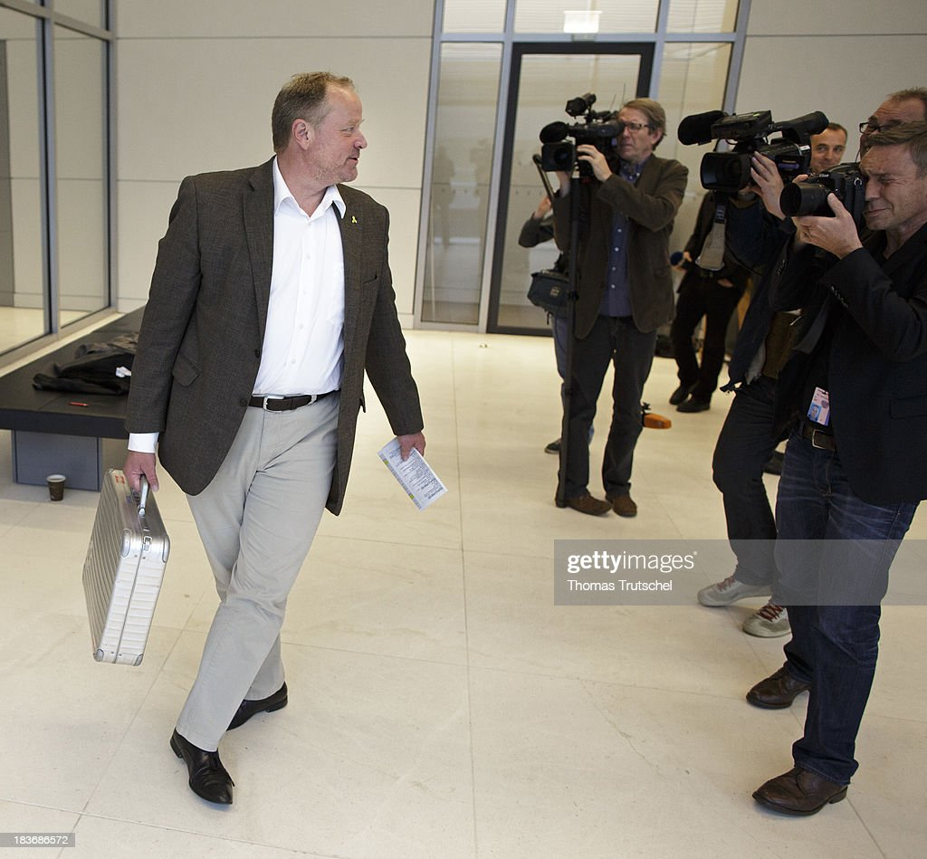 German Development Minister <a gi-track='captionPersonalityLinkClicked' href=/galleries/search?phrase=Dirk+Niebel&family=editorial&specificpeople=710721 ng-click='$event.stopPropagation()'>Dirk Niebel</a> leaf after the last Party parliamentary group's meeting of German Free Democrats (FDP) at the lower house of parliament Bundestag on October 08, 2013 in Berlin Germany,