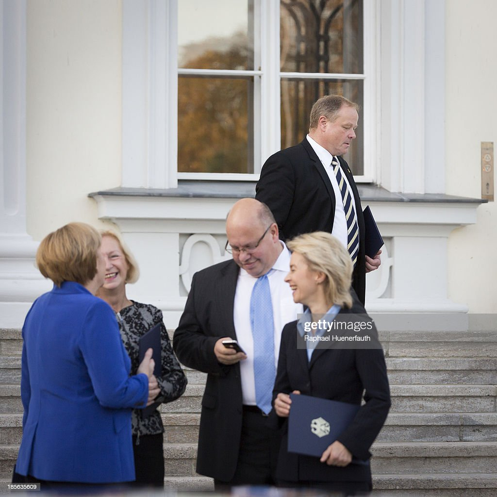 German Development Minister <a gi-track='captionPersonalityLinkClicked' href=/galleries/search?phrase=Dirk+Niebel&family=editorial&specificpeople=710721 ng-click='$event.stopPropagation()'>Dirk Niebel</a> (behind) leaves the Bellevue, (infront L-R) German Chancellor <a gi-track='captionPersonalityLinkClicked' href=/galleries/search?phrase=Angela+Merkel&family=editorial&specificpeople=202161 ng-click='$event.stopPropagation()'>Angela Merkel</a>, German Education Minister <a gi-track='captionPersonalityLinkClicked' href=/galleries/search?phrase=Johanna+Wanka&family=editorial&specificpeople=5626570 ng-click='$event.stopPropagation()'>Johanna Wanka</a>, Bundesumweltminister <a gi-track='captionPersonalityLinkClicked' href=/galleries/search?phrase=Peter+Altmaier&family=editorial&specificpeople=4109723 ng-click='$event.stopPropagation()'>Peter Altmaier</a>, CDU, and German Labor Minister <a gi-track='captionPersonalityLinkClicked' href=/galleries/search?phrase=Ursula+von+der+Leyen&family=editorial&specificpeople=4249207 ng-click='$event.stopPropagation()'>Ursula von der Leyen</a>, after German President Gauck hands outgoing Federal Ministers their dismissal certificate at a ceremony for the outgoing German government at Bellevue Palace, on October 22, 2013 in Berlin, Germany. The ministers will stay on in their functions until a new government is formed, which will most likely be a coalition between the German Christian Democrats (CDU) and the German Social Democrats (SPD). For the FDP members the ceremony today is especially poignant, as the party failed in recent German elections to receive the 5% minimum of votes necessary to retain its seats in the Bundestag, which means the party no longer has political say on the federal level.