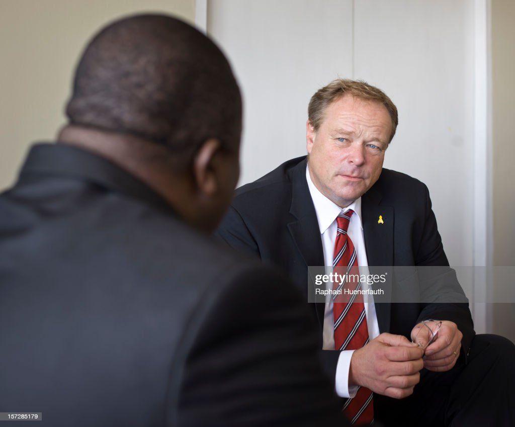 German Development Minister Dirk Niebel (R) meets Tapiwa Mashakada (L), MDC-T, Zimbabwean Minister of Economic Planning and Investment Promotion, at Harare International Airport on December 1, 2012 in Harare, Zimbabwe. German Development Minister Niebel is the first member of the German government to visit Zimbabwe in 15 years. The visit, aimed at supporting democratic forces in the African country, comes ahead of their presidential elections in 2013.