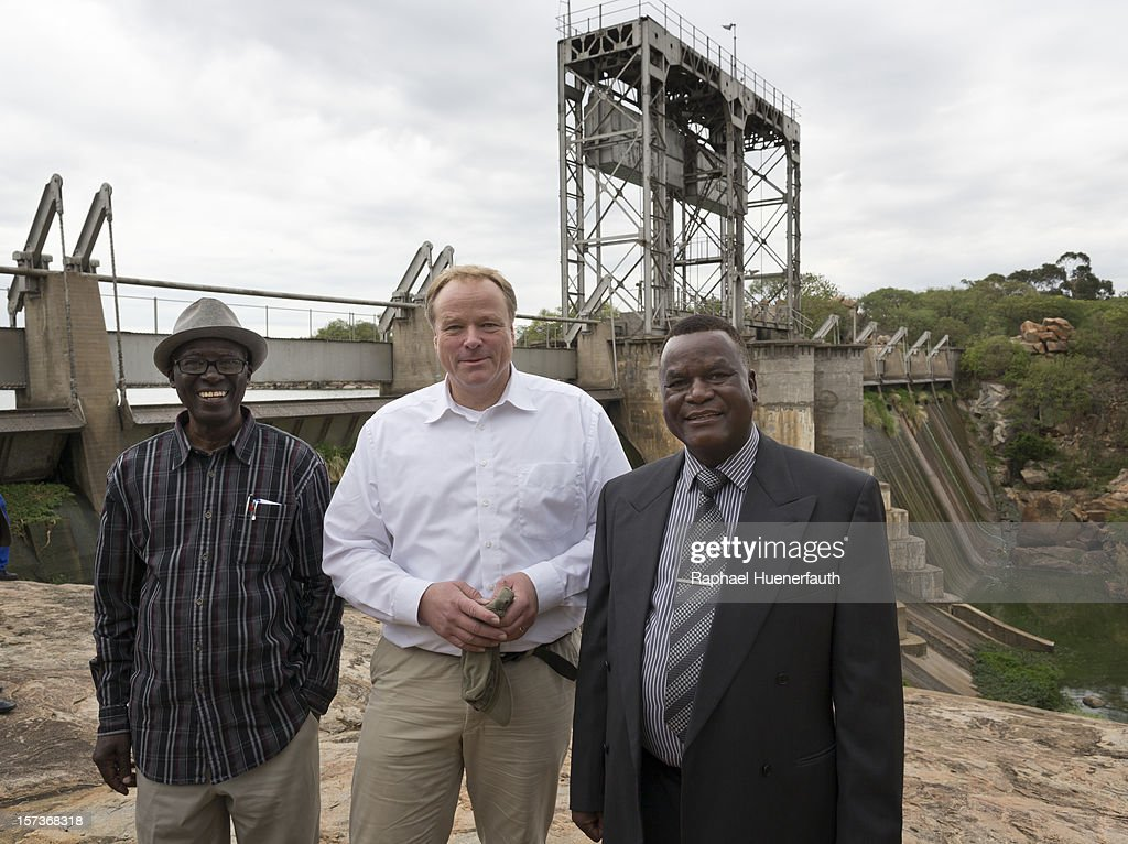 German Development Minister Dirk Niebel (C), Sam Siepa Nkomo (L), MDC-T, Water Minister of Zimbabwe, Thaba Moyo (R), MDC-T, Mayor of Bulawayo, visit the Khami water plant on December 2, 2012 in Bulawayo, Zimbabwe. German Development Minister Niebel is the first member of the German government to visit Zimbabwe in 15 years. The visit, aimed at supporting democratic forces in the African country, comes ahead of their presidential elections in 2013.