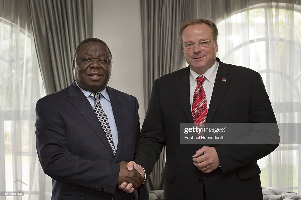 German Development Minister Dirk Niebel (R) shakes hands with zimbawean Prime Minister <a gi-track='captionPersonalityLinkClicked' href=/galleries/search?phrase=Morgan+Tsvangirai&family=editorial&specificpeople=800701 ng-click='$event.stopPropagation()'>Morgan Tsvangirai</a> (L), MDC-T, in his residence on December 3, 2012 in Harare, Zimbabwe. German Development Minister Niebel is the first member of the German government to visit Zimbabwe in 15 years. The visit, aimed at supporting democratic forces in the African country, comes ahead of their presidential elections in 2013.
