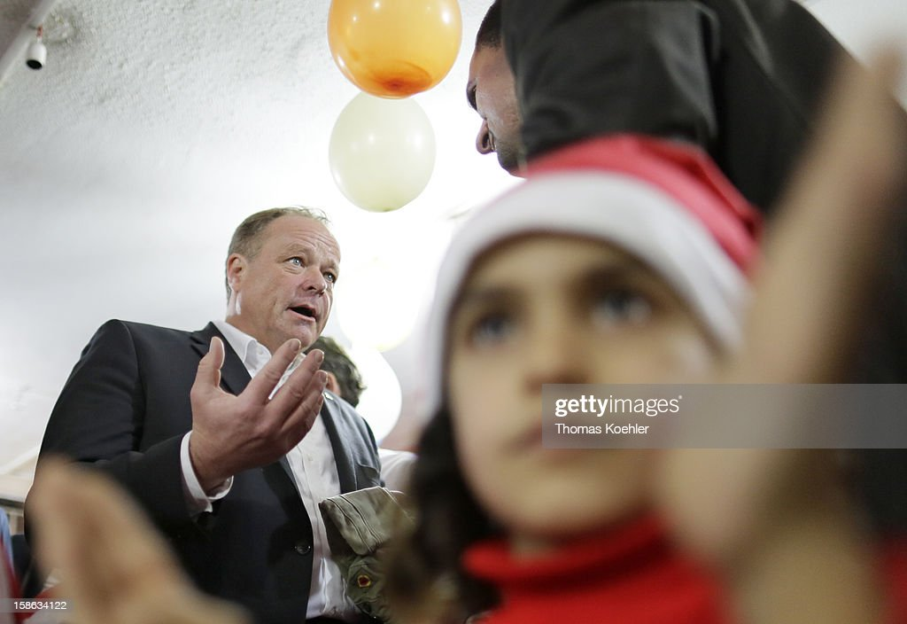 German Development Minister Dirk Niebel visits the Bourj el-Barajneh Refugee Camp on December 22, 2012 in Beirut, Lebanon. Niebel will take a close look at the activities of the United Nations Relief and Works Agency (UNRWA) and the relief effort to Syrian refugee children by UNICEF.