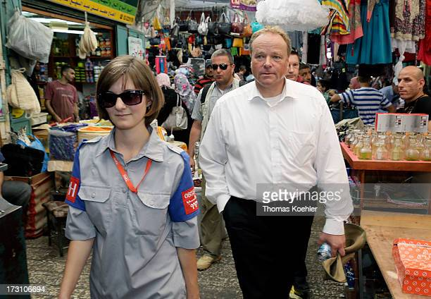 German Development Minister Dirk Niebel visits with Alina Muelhauser the old quarter in sector H2 in Hebron which is under control of Israel on July...
