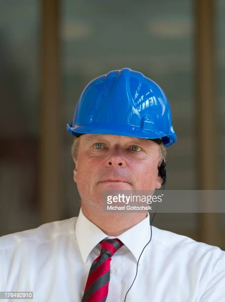 German Development Minister Dirk Niebel wears a blue helmet during his visit of hydroelectric power station on August 8 2013 in Perucica Montenegro...
