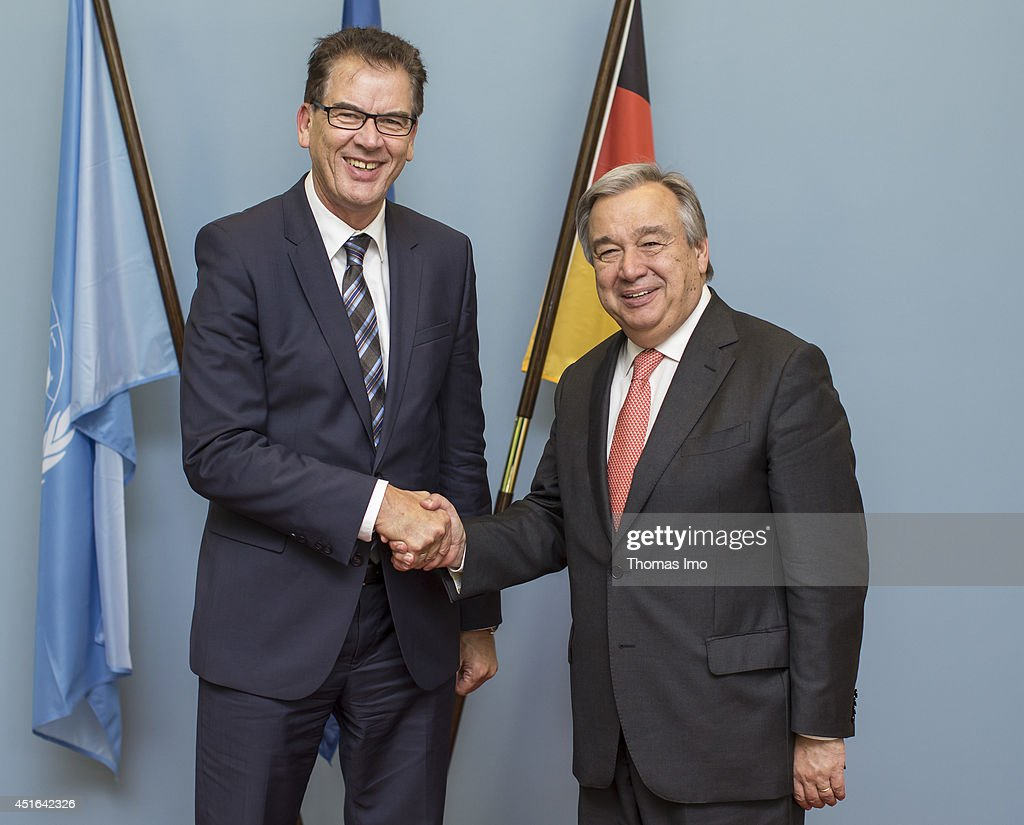 German Development Minister Gerd Mueller and United Nations High Commissioner for Refugees (UNHCR) Antonio Guterres shake hands before their meeting over refugees, on July 03, 2014 in Berlin, Germany.