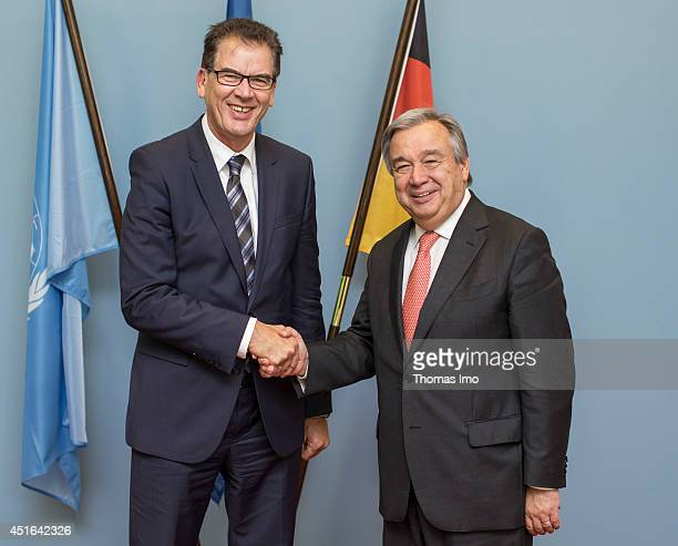 German Development Minister Gerd Mueller and United Nations High Commissioner for Refugees Antonio Guterres shake hands before their meeting over...