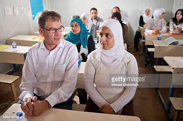 German Development Minister Gerd Mueller meets with Syrian female refugee teachers in UNHCRCamp Kawergosk for Syrian refugees during his visit to the...