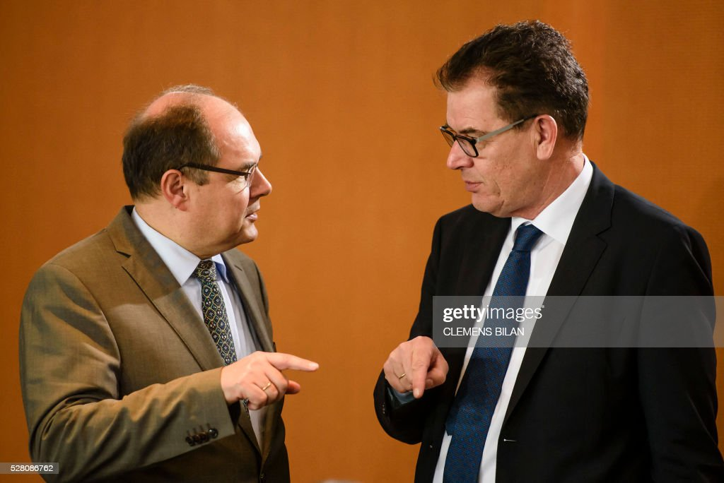 German Development Minister Gerd Mueller (R) talks with German Agriculture Minister Christian Schmidt prior to the weekly cabinet meeting at the Federal Chancellery in Berlin, on May 4, 2016. / AFP / CLEMENS