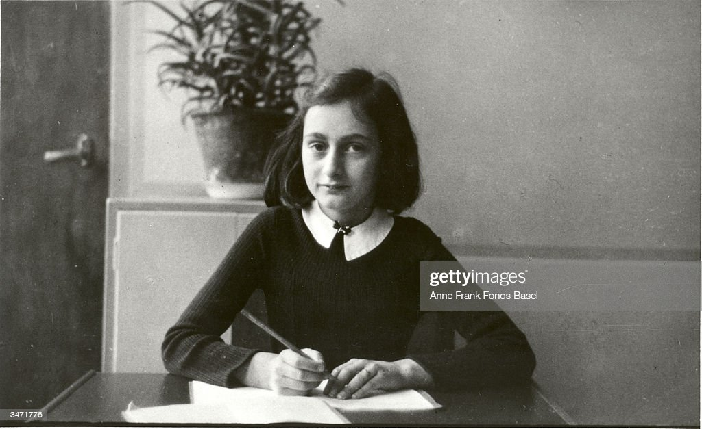 German diarist <a gi-track='captionPersonalityLinkClicked' href=/galleries/search?phrase=Anne+Frank&family=editorial&specificpeople=173492 ng-click='$event.stopPropagation()'>Anne Frank</a> (1929 - 1945) writes at her desk prior to her and her family going into hiding during World War II, Amsterdam, Netherlands, early 1940s.