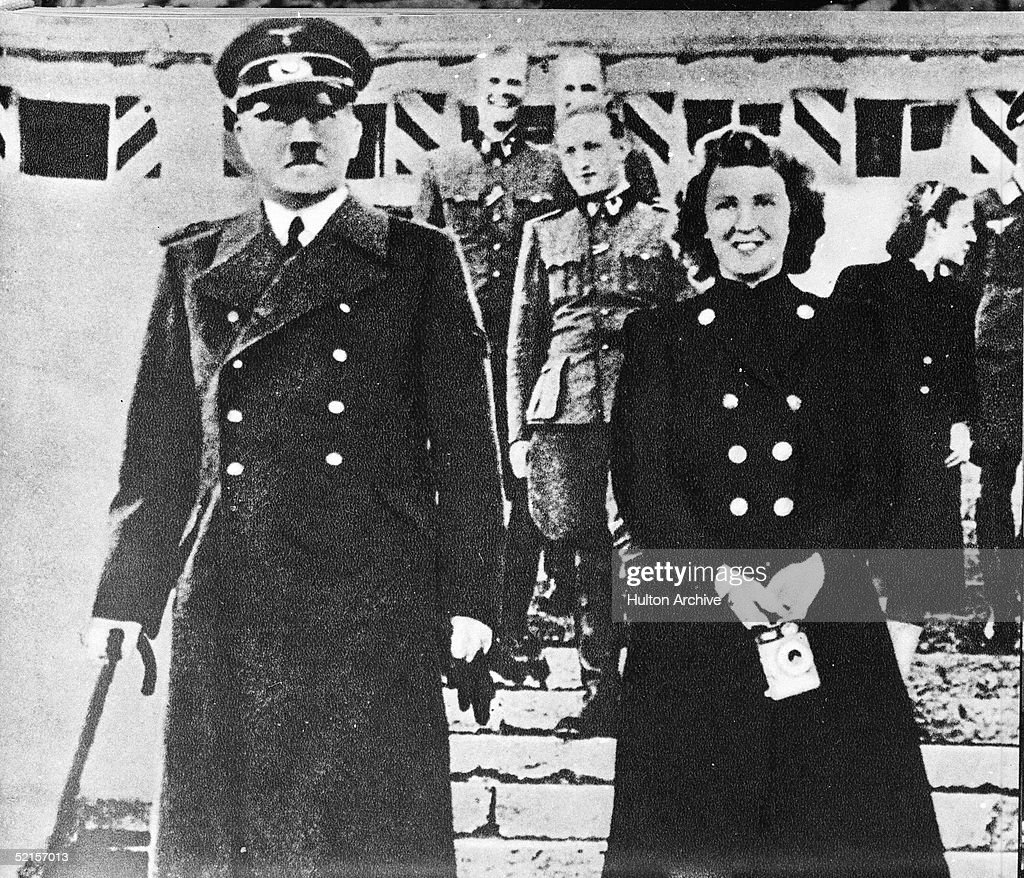 German dictator Adolf Hitler (1889 - 1945) with his mistress Eva Braun (1912 -1945), whom he married on April 29, 1945, the day before they committed suicide, early to mid 1940s. Hitler holds a cane, and Braun holds a camera.