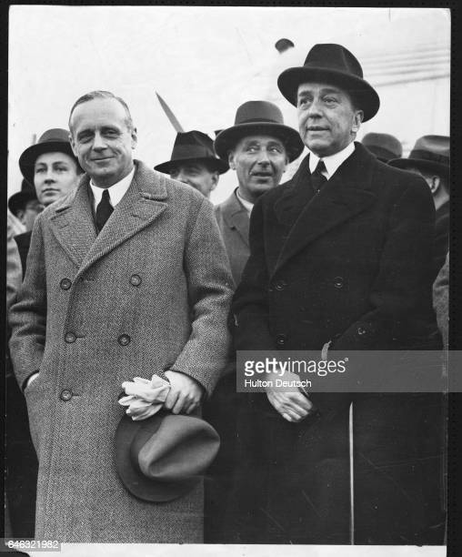 German diplomat Joachim Von Ribbentrop is greeted by the German ambassador to London Hoesch as he arrives for the League Council meeting