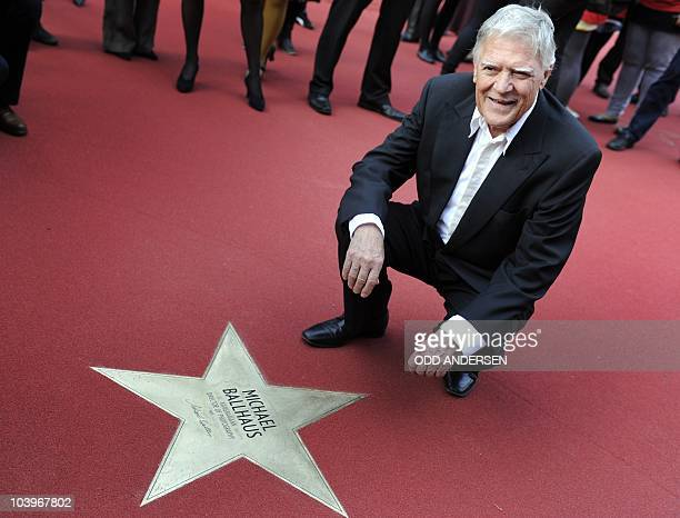 German director of photography Michael Ballhaus poses next to his star during the opening of the 'Boulevard der Stars' in Berlin September 10 2010...