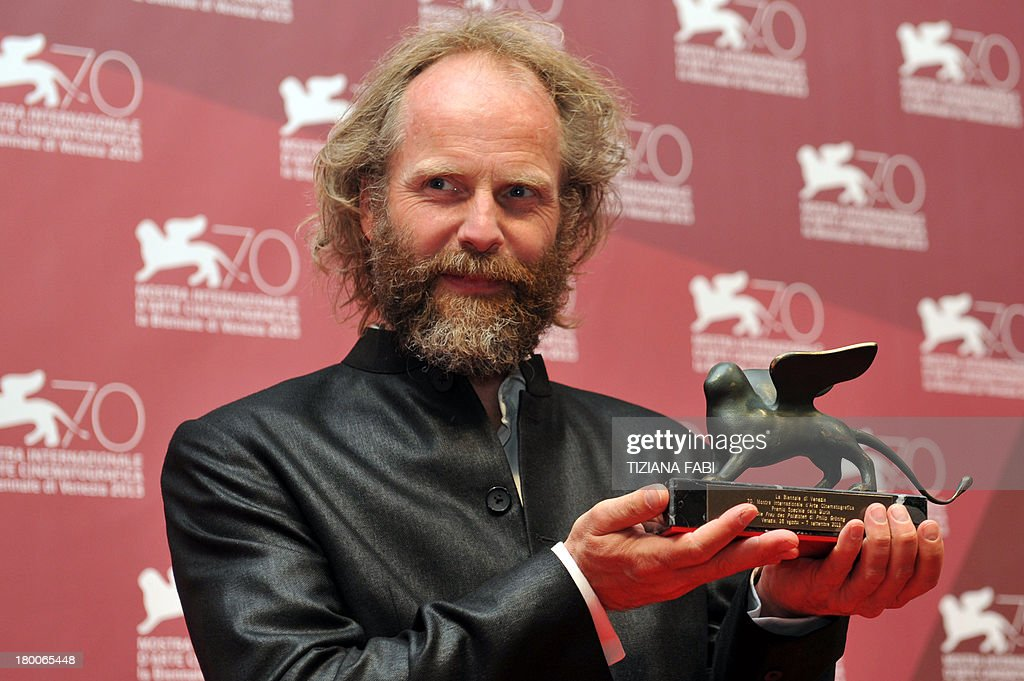 German director Philip Groning poses with the Special Jury Prize he received for his movie 'Die Frau Des Polizisten' (The police officer's wife) during the award ceremony of the 70th Venice Film Festival on September 7, 2013 at Venice Lido.