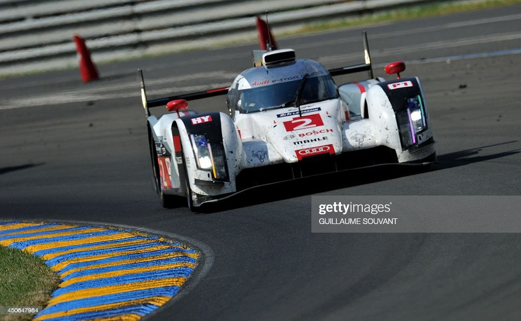 German driver Andre Lotterer in his Audi R18 E-Tron Quattro Hybrid N°2 competes during the 82nd Le Mans 24 hours endurance race, on June 15, 2014 in Le Mans, western France. Fifty-six cars with 168 drivers are participating on June 14 and 15 in the Le Mans 24-hours endurance race.