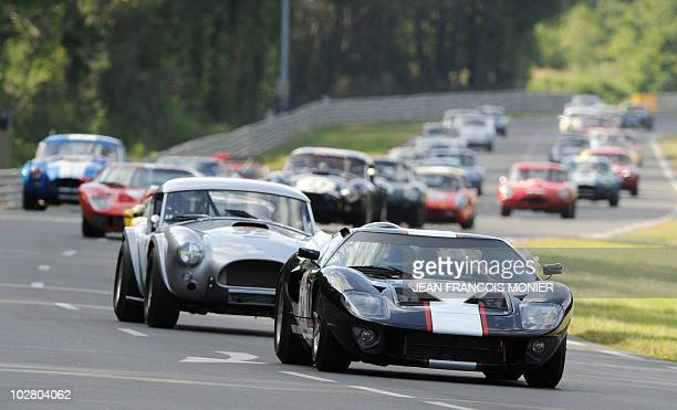 German driver Christian Glasel in his Ford GT 40 competes ahead of Portuguese Miguel Amaral in his 1964's AC Cobra during the 5th edition of the 'Le...