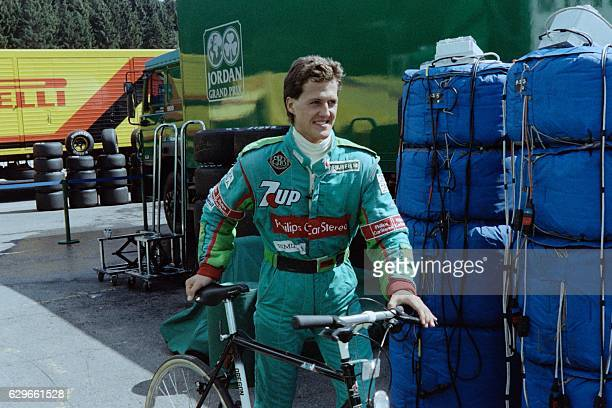 German driver Michael Schumacher arrives at the pit lane with his bycicle to participate in the firs qualifying trial for the Belgian Formula One...