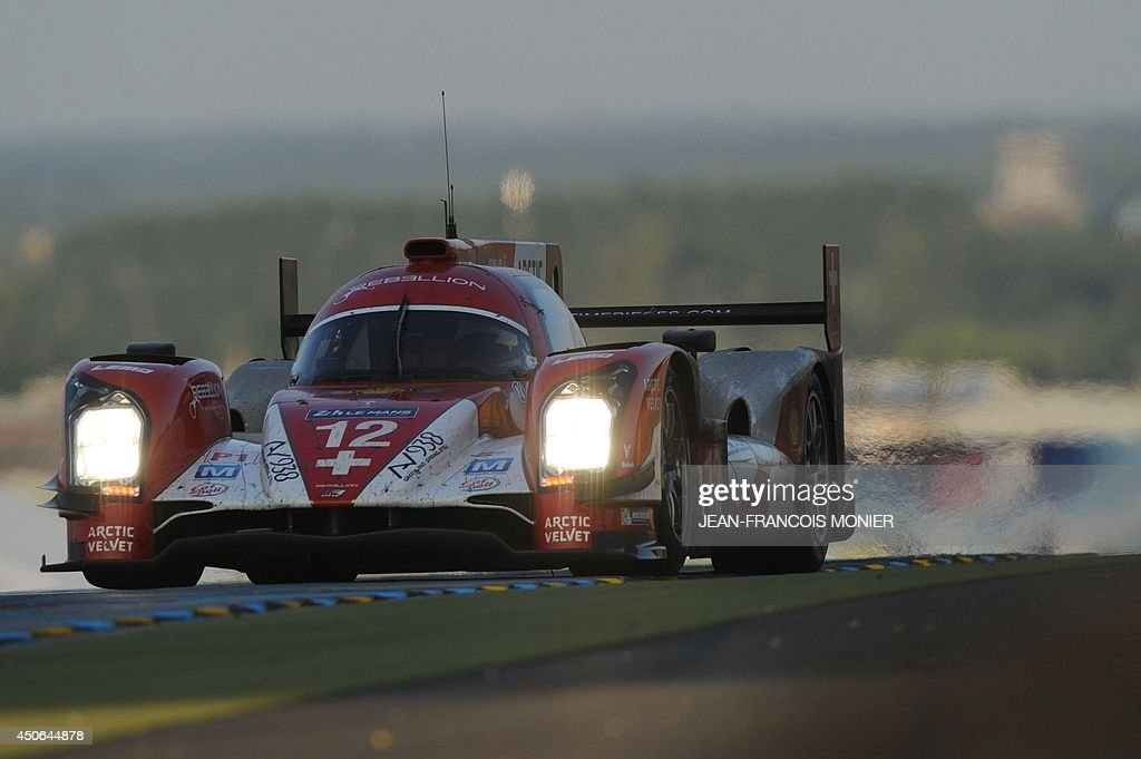 German driver Nick Heidfeld in his Rebellion R-One -Toyota N° 12 competes during the 82nd Le Mans 24 hours endurance race, on June 15, 2014 in Le Mans, western France. Fifty-six cars with 168 drivers are participating on June 14 and 15 in the Le Mans 24-hours endurance race. AFP PHOTO / JEAN FRANCOIS MONIER