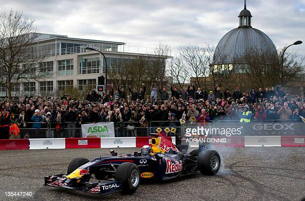 German driver Sebastian Vettel spins his Formula One racing car on Midsummer Boulevard in downtown Milton Keynes on December 10 2011 World Champion...