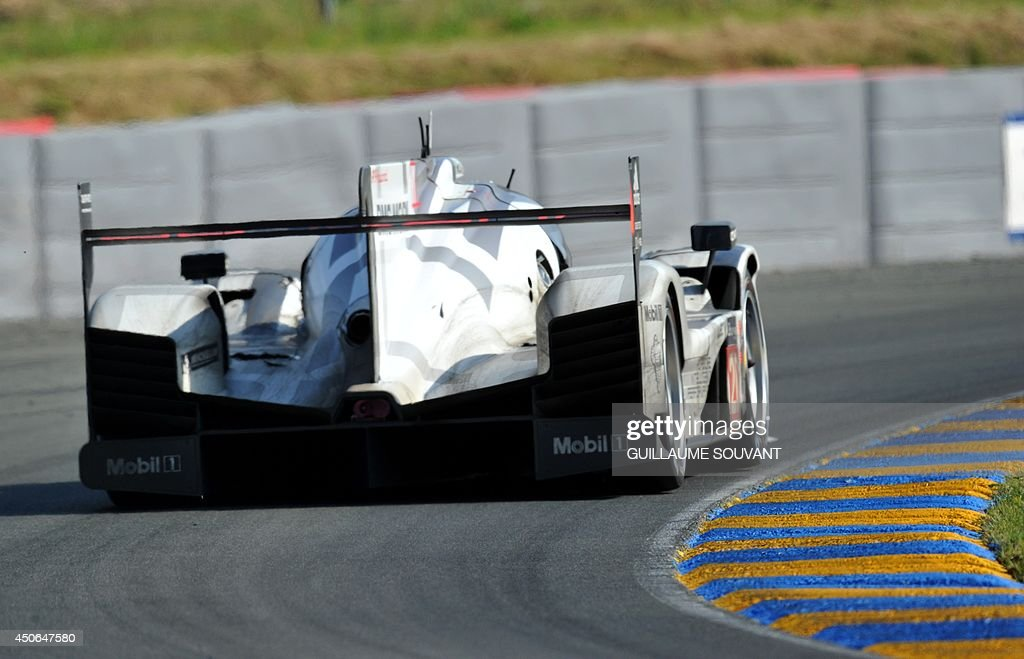 German driver Timo Bernhard in his Porsche 919 Hybrid N° 20 competes during the 82nd Le Mans 24 hours endurance race, on June 15, 2014 in Le Mans, western France. Fifty-six cars with 168 drivers are participating on June 14 and 15 in the Le Mans 24-hours endurance race.