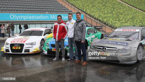 German DTM drivers Ralf Schumacher of Mercedes Benz Dirk Werner of BMW and Timo Scheider of Audi pose for photographers after a news conference on...