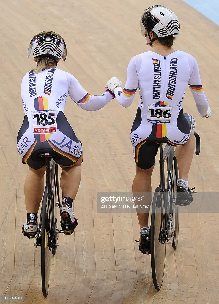 German duo Kristina Vogel (R) and Mariam Welte celebrate their victory in the womens' team sprint event of the UCI Track Cycling World Championships in Minsk on February 20, 2013.