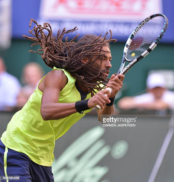 German Dustin Brown hits the ball during his match against Rafael Nadal of Spain at the ATP Gerry Weber Open tennis tournament in Halle western...