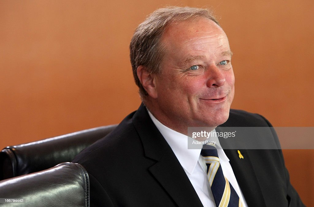 German Economic Cooperation and Development Minister Minister <a gi-track='captionPersonalityLinkClicked' href=/galleries/search?phrase=Dirk+Niebel&family=editorial&specificpeople=710721 ng-click='$event.stopPropagation()'>Dirk Niebel</a> arrives for the weekly German federal government Cabinet meeting on April 17, 2013 in Berlin, Germany. High on the morning's agenda was discussion of the country's government financial stability program, as well as Operation Atalanta, also known as European Union Naval Force Somalia, the EU-led fight against piracy on the Somalian coast, and of health insurance and medication policy.