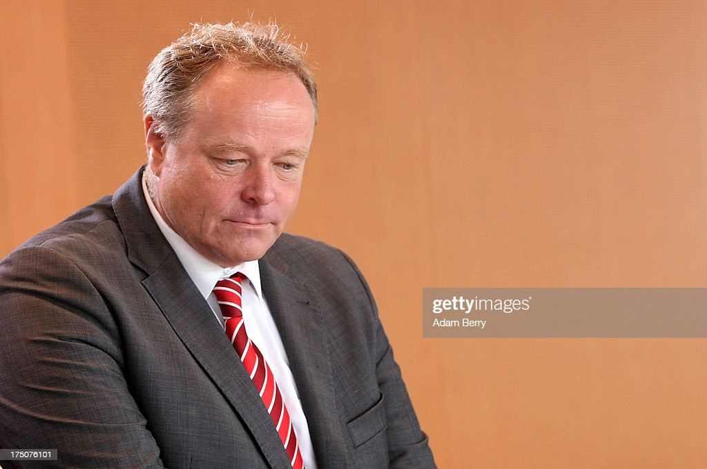German Economic Cooperation and Development Minister Minister <a gi-track='captionPersonalityLinkClicked' href=/galleries/search?phrase=Dirk+Niebel&family=editorial&specificpeople=710721 ng-click='$event.stopPropagation()'>Dirk Niebel</a> arrives for the weekly German federal Cabinet meeting on July 31, 2013 in Berlin, Germany. High on the morning's agenda was discussion of the country's 2012 energy report.