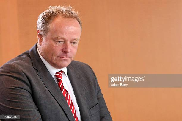 German Economic Cooperation and Development Minister Minister Dirk Niebel arrives for the weekly German federal Cabinet meeting on July 31 2013 in...