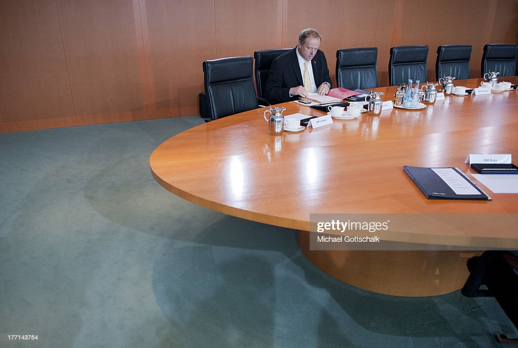 German Economic Cooperation and Development Minister Minister <a gi-track='captionPersonalityLinkClicked' href=/galleries/search?phrase=Dirk+Niebel&family=editorial&specificpeople=710721 ng-click='$event.stopPropagation()'>Dirk Niebel</a> arrives for the weekly federal Cabinet meeting on August 21, 2013 in Berlin, Germany. High on the morning's agenda was discussion of future sustainable development.