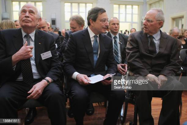 German economist and former Bundesbank President Hans Tietmeyer President of the European Central Bank Mario Draghi and German Finance Minister...