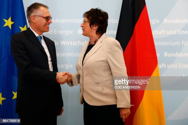 German Economy and Energy Minister Brigitte Zypries and Carlos Tavares Chairman of the Managing Board of PSA Peugeot Citroën shake handsd prior to...
