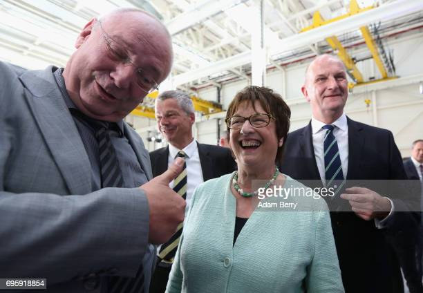 German Economy and Energy Minister Brigitte Zypries and Dietmar Woidke prime minister of the state of Brandenburg visit the assembly line for the...