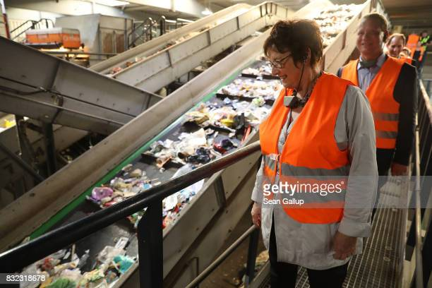 German Economy and Energy Minister Brigitte Zypries looks at discarded plastics on a conveyor at the ALBA sorting center for the recycling of...