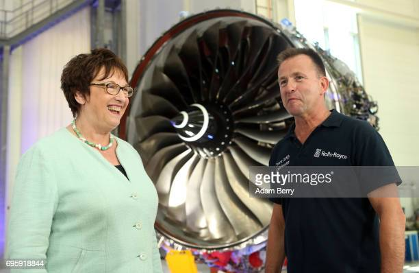 German Economy and Energy Minister Brigitte Zypries speaks to RollsRoyce production introduction manager Uwe Rudolf on the assembly line for the...
